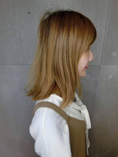 髮根也長出一小段了